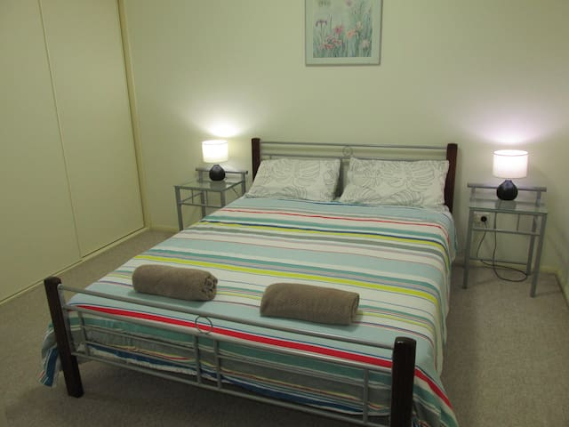 Main Bedroom with Queen Bed, Built in Wardrobes, and 2 way En-suite Bathroom.  For the first 2 Persons in the booking.  # Any extra beds must be paid for separately.