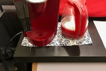 A Keurig and a hot water heater for making coffee and tea.