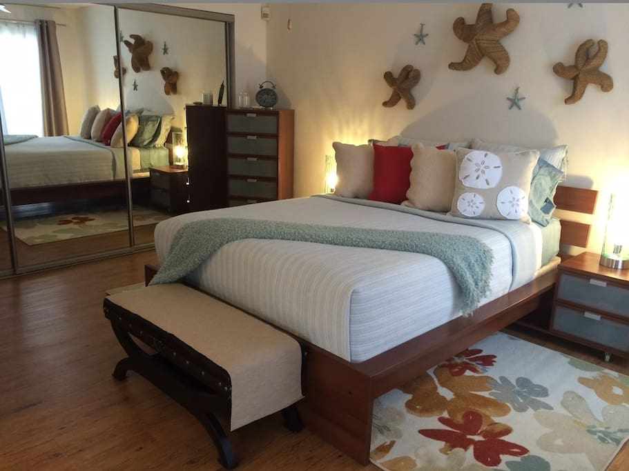 Fresh & clean linens, large mirrored wardrobe doors & hangers in closet, 2 chest of drawers, 2 night stands, Bose Sound System and sliding glass door to patio