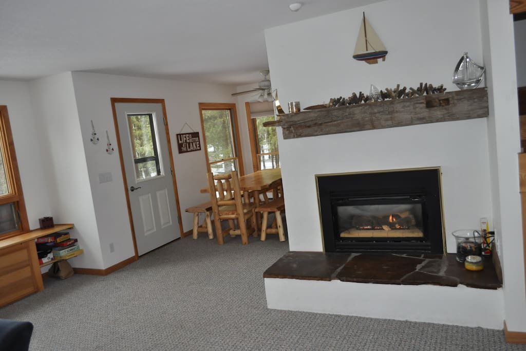 Fireplace to the right and cedar dining table to the left.
