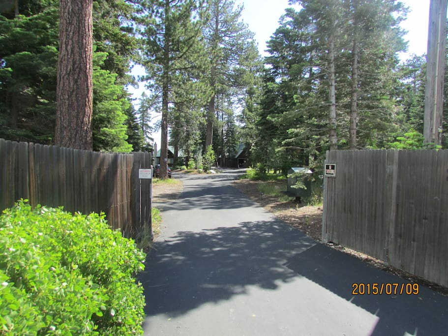 private front entry and private driveway give you an idea of the scope of this full acre of lakefront property