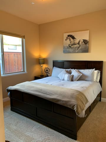 King size guest room with a TV