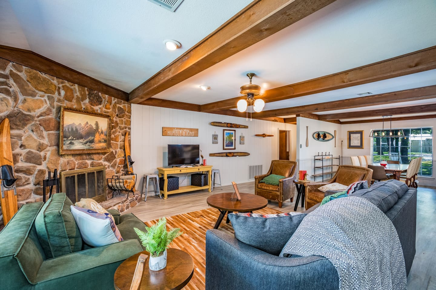 We love this living room. Perfect for a warm fire, watching the big game on Direct TV,  viewing the lake, or watching the kiddos play in the back yard. Dining room and kitchen are open to this room on the right.
