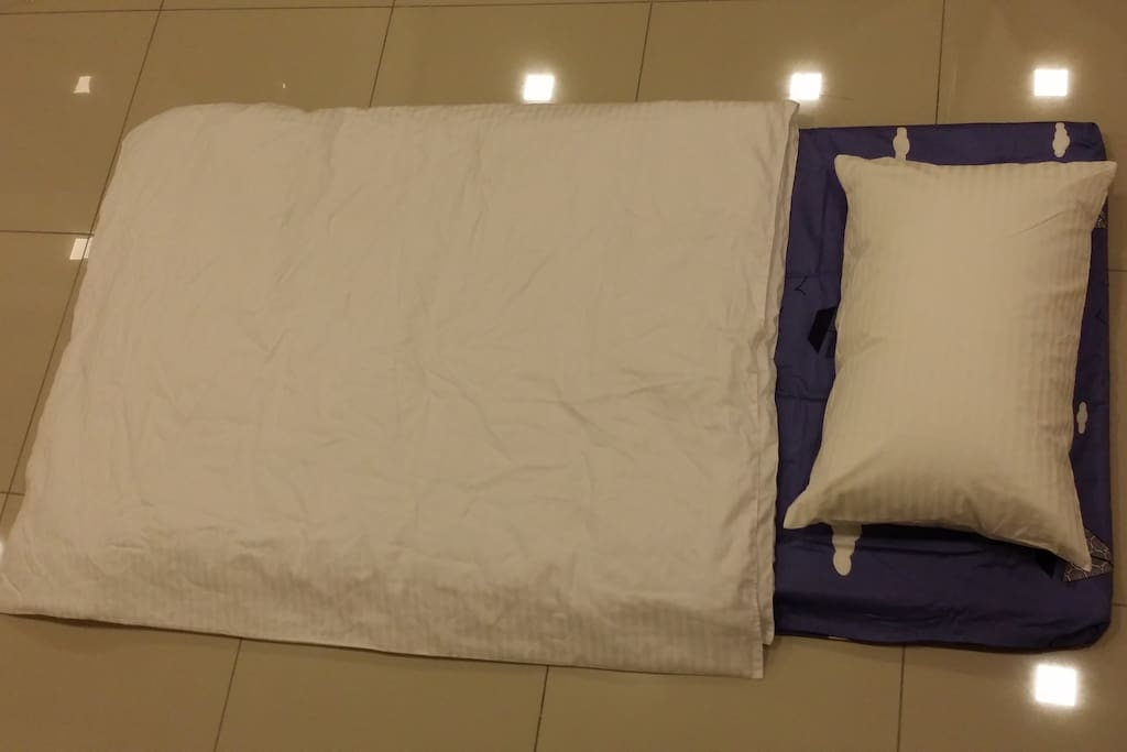 Extra Floor Mattress completed with bed linen.