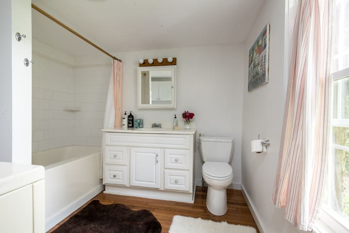 Private bath, with a washer/dryer.