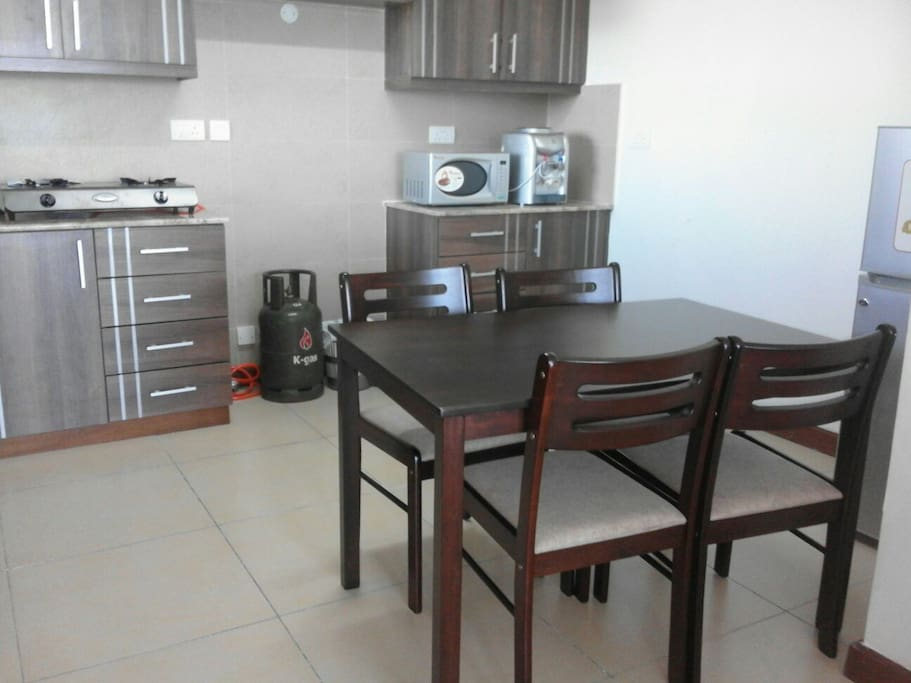 Kitchen with a Dinning Table for 4 Guests