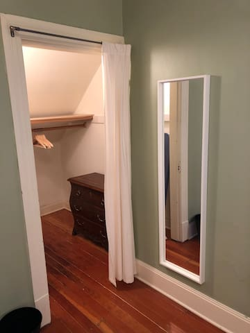 Closet with dresser and ironing board