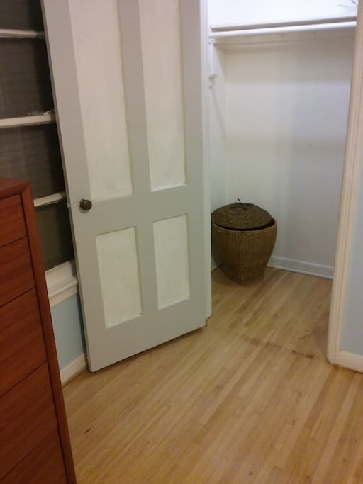 (2) closets in master bedroom with laundry basket