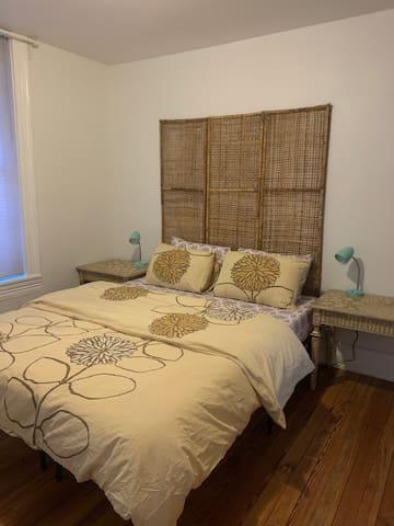 Comfortable bed in master bedroom