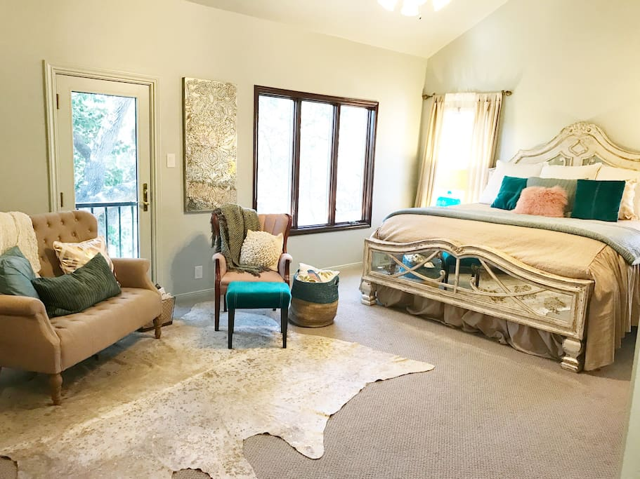 Perched on the second floor among the oak trees, our master bedroom features a king size bed, a cozy reading area.