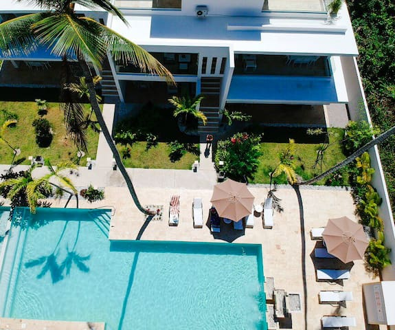 FAB NEW APARTMENT,  LARGE POOL Steps to Beachfront