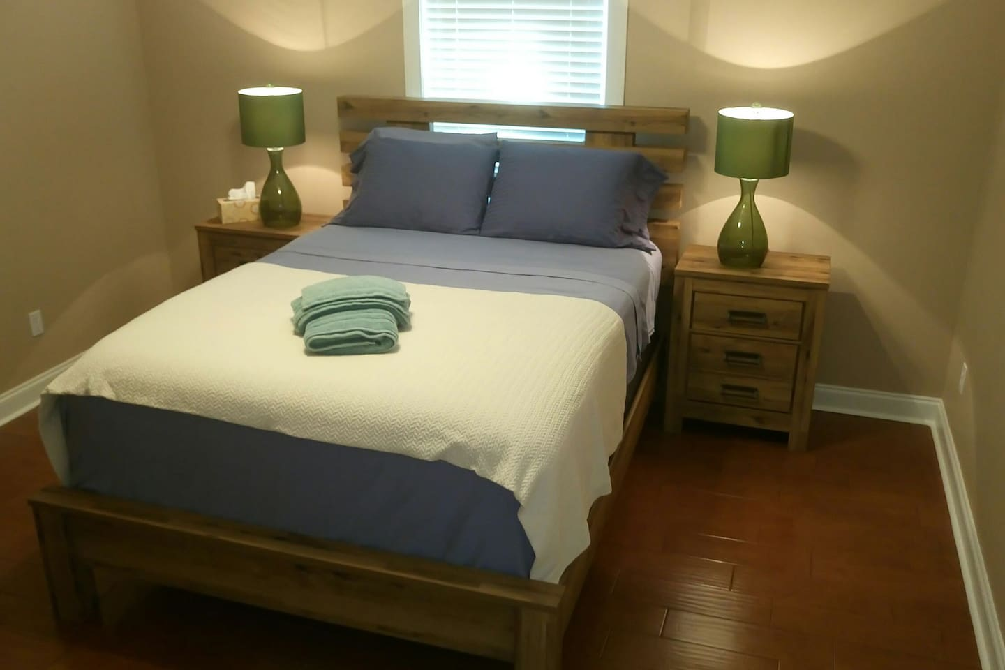 Master Bedroom - the nightstands have a USB connector in the back to charge mobile phones.