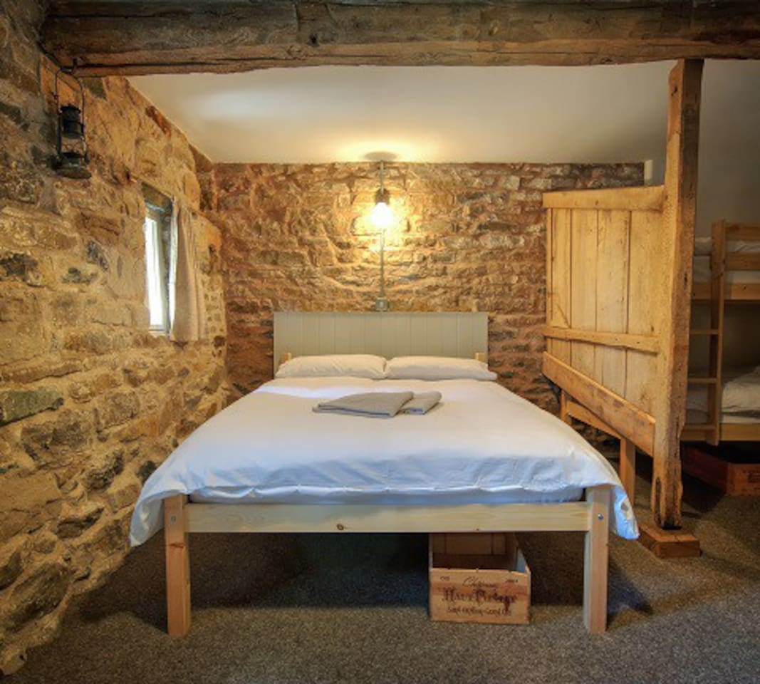Double bed with stall providing privacy.  Underfloor heating