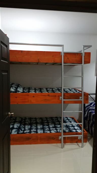 K-38 Invention Triple Single Bunk Beds for Kids or Friends. My 7 year old calls the top bunk