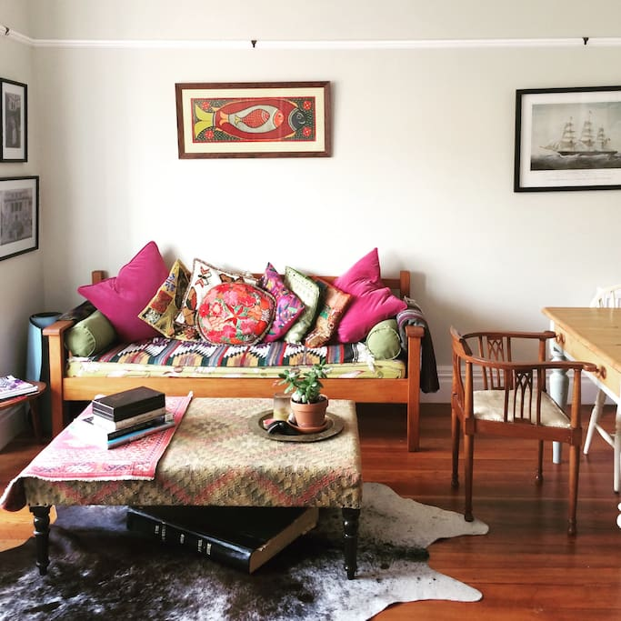Our house is decorated with items collected on our travels to India and Mexico, antiques, interesting collectibles (the galley book of newspapers under the ottoman) and wedding presents (the cowhide!)....as well as many house plants