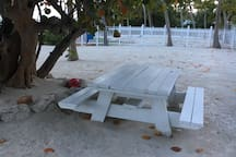 Shaded, Wooden picnic table with ocean view - where we have most our meals