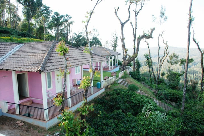 Cottage facing misty hills of Madikeri
