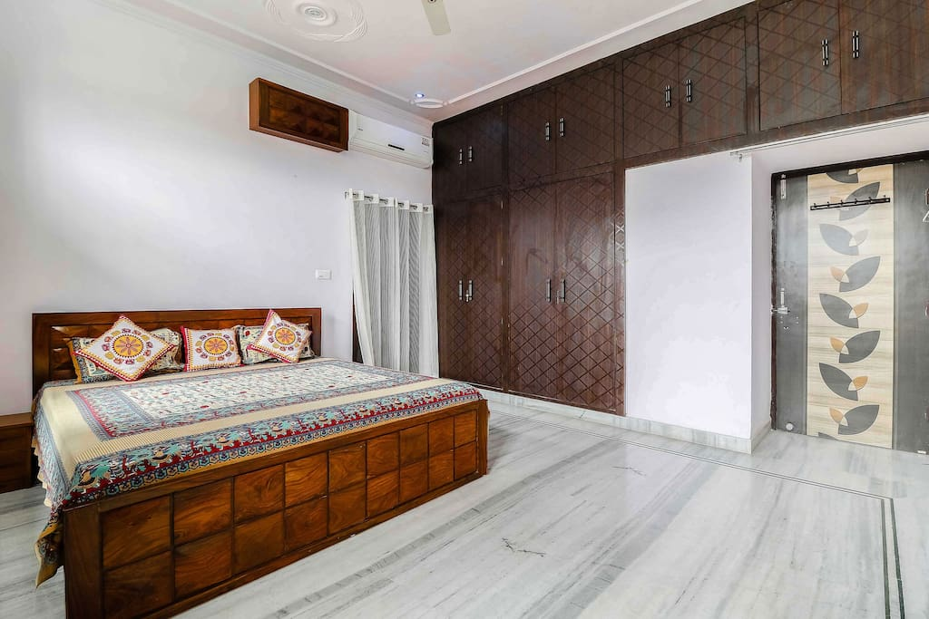 Air conditioned double bed room with balcony and private washroom.