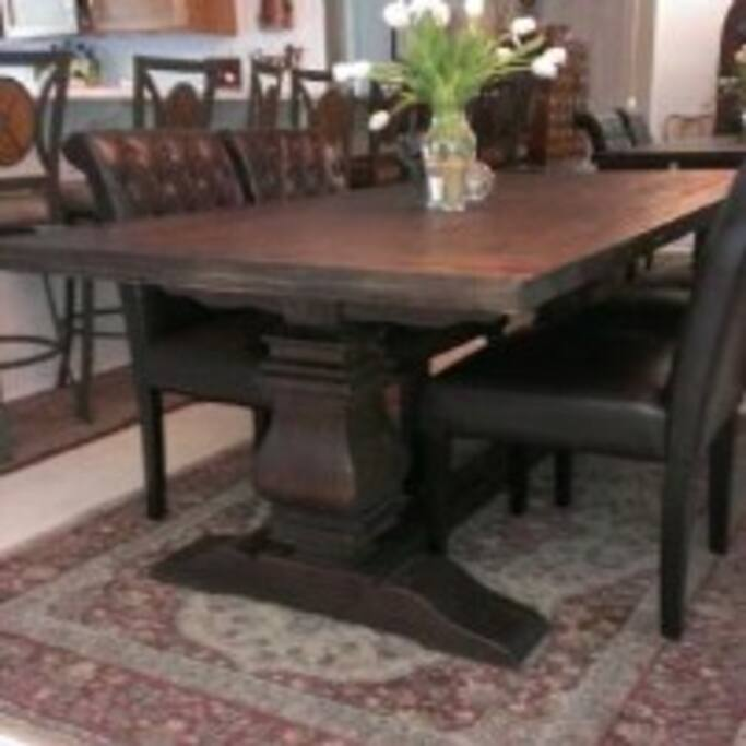 We love this Restoration Hardware dining table and leather chairs.