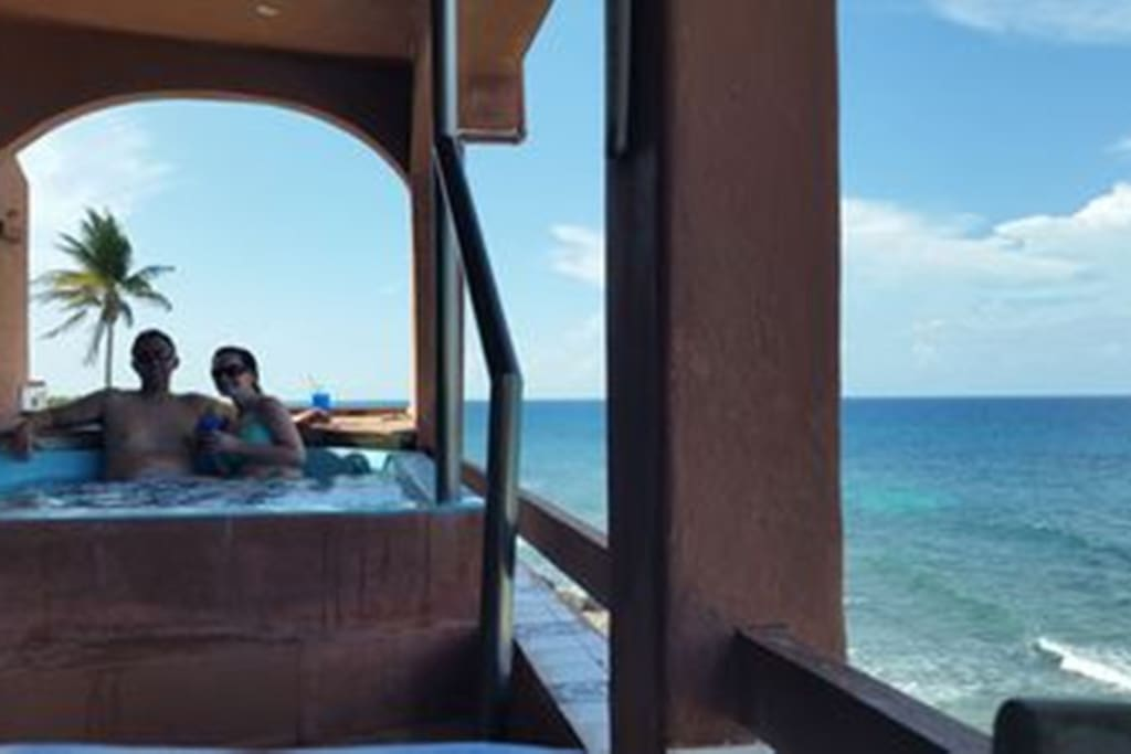 Amazing views of the Caribbean from the over-sized jacuzzi!  Room for 4 adults!