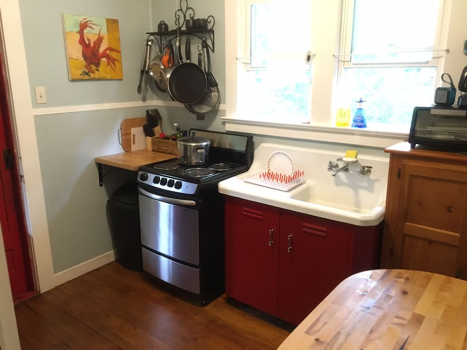 Kitchen with updated stove, refrigerator, microwave and toaster oven.