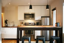 Remodeled kitchen with eat at bar.