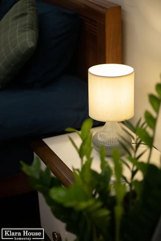 Cozy lamp near bed