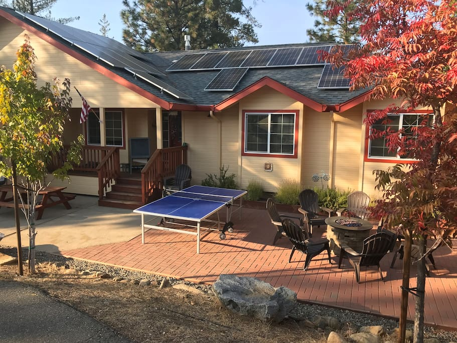 "Recently installed solar panels (8.6kw).  We strive to make our house as ""green"" as we can.  Outdoor living spaces as  large and nice as indoors -- landscaped front yard with ping pong table, fire pit, picnic table..."