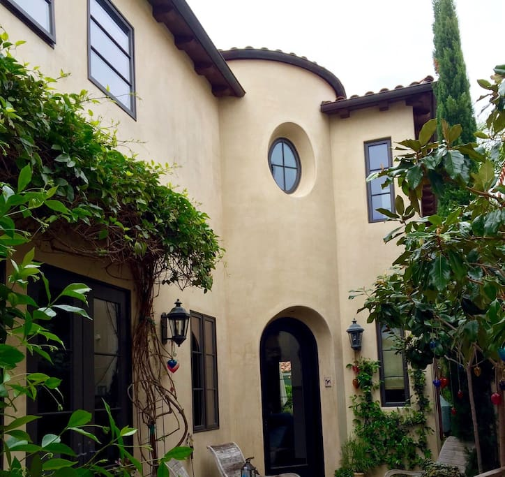 Charming courtyard entrance to this gorgeous Lido Isle home