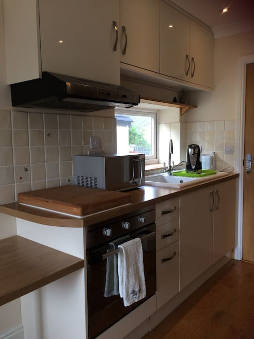 Kitchen with use of kettle, toaster, microwave & fridge.