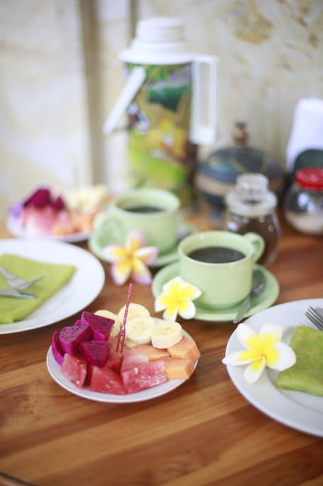 Wow the one of our best breakfast. Banana pancake with natural green color from suji leaf. Also served with mix fruit, black/milk coffee and tea. Its looks so perfect. Enjoy your meal.