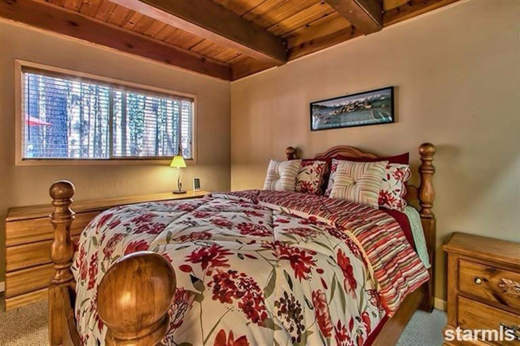 Downstairs bedroom with queen & twin bed.