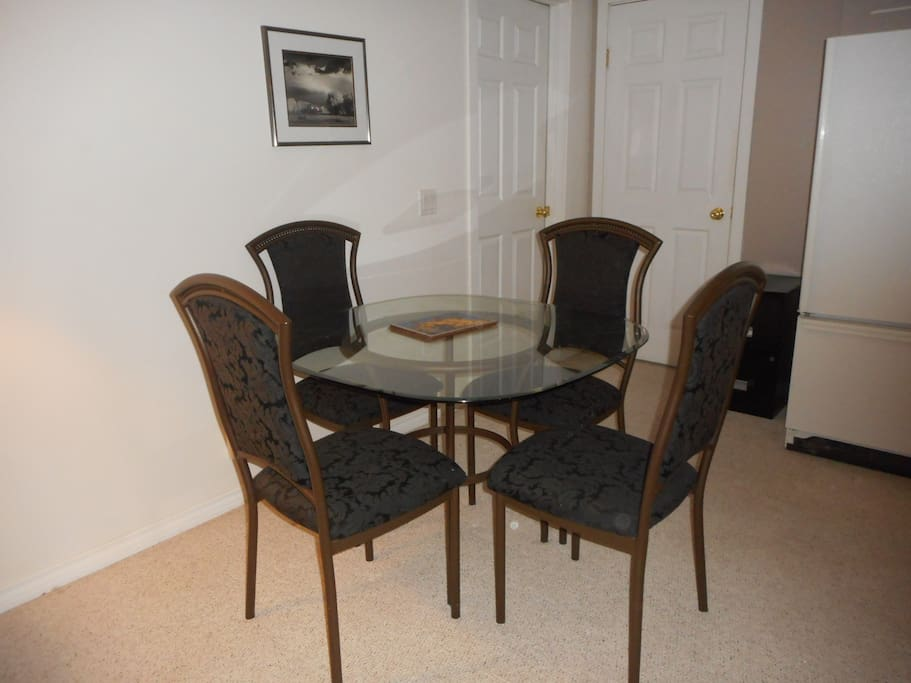 Glass dinette with fabric chairs
