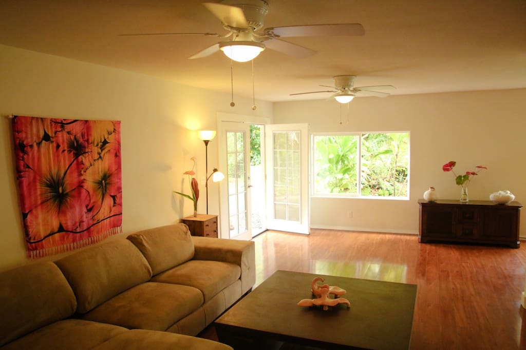Downstairs living room.  Ceiling fans throughout helps keep this home really comfortable