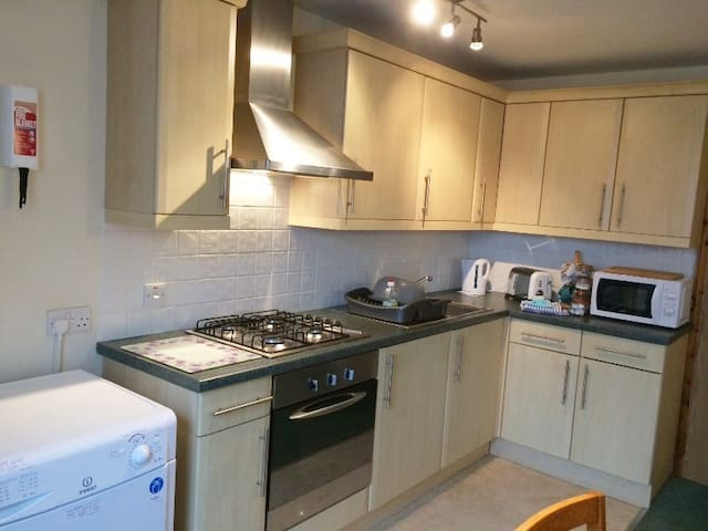 Living area: fitted kitchen, gas hob, electric oven & hood, fitted fridge & small freezer compartment, sink, plentiful crockery & cooking equipment. Microwave, kettle, toaster. Tumble dryer. Small selection of tea & coffee is provided to welcome you.