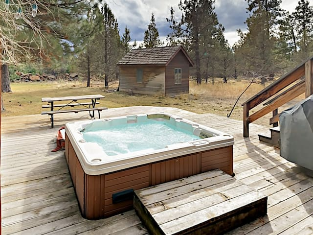 Enjoy a private hot tub in your own backyard, perfect for relaxing evenings at home.