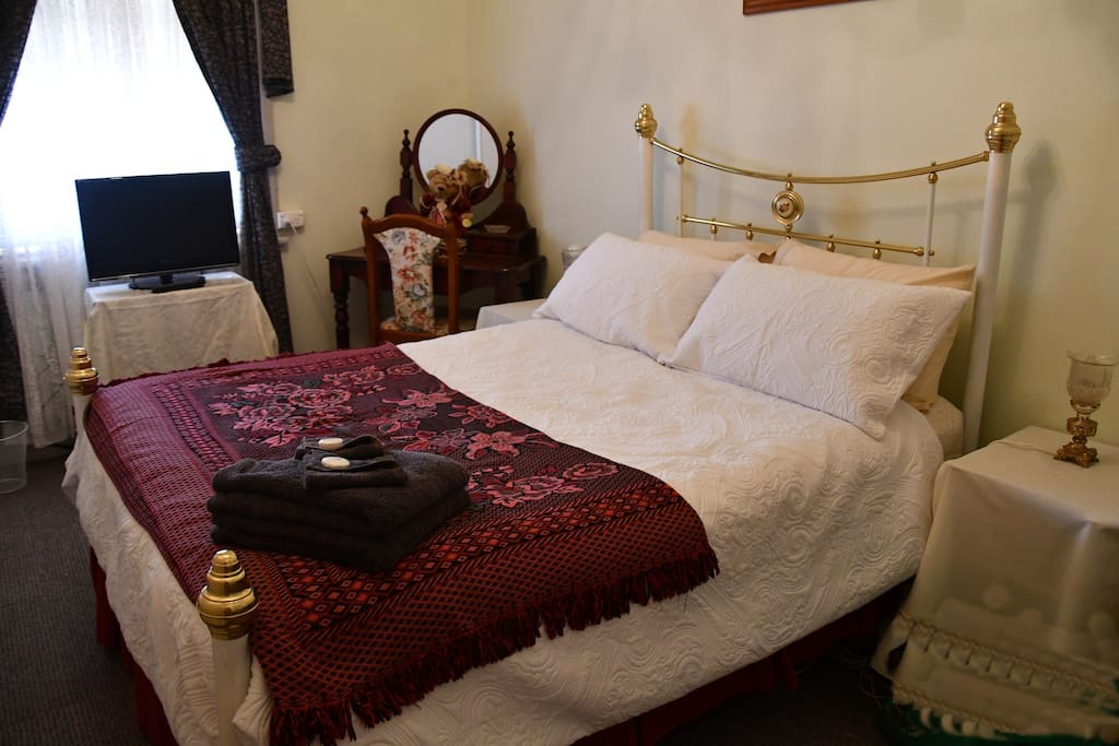 Room 4 is in the main house and next to the bathroom, it has a double bed, electric blanket, ducted cooling, a dressing tale with chair and a small T.V.