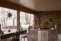 Large covered outdoor patio with seating.  Gas barbque with fridge, sink and storage available for your use during spring, summer and autumn months prior to and after first and last frost dates.