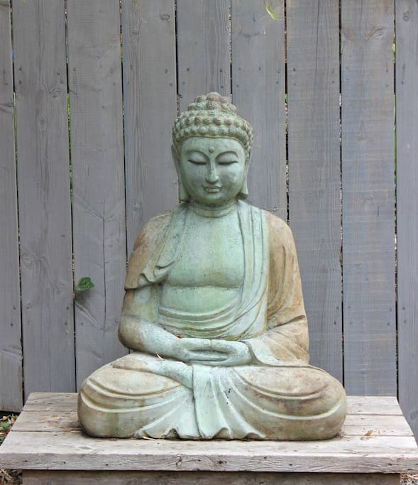 A buddha greets you when you walk into the yard
