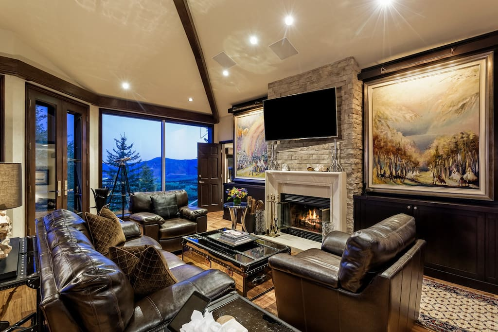 The family room on the second floor features a flat-screen TV and amazing original artwork.