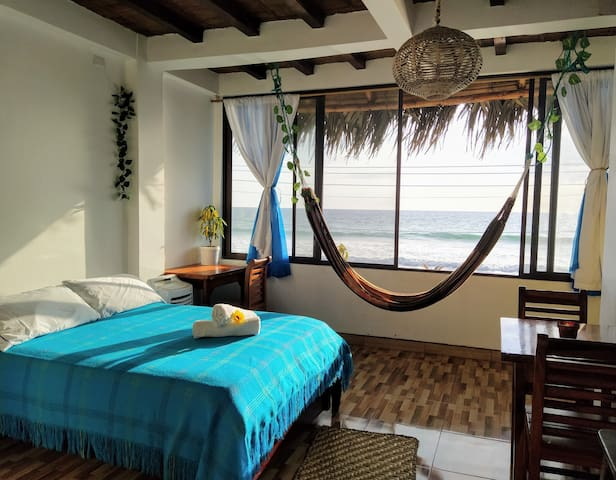 Suite in front of the beach per month