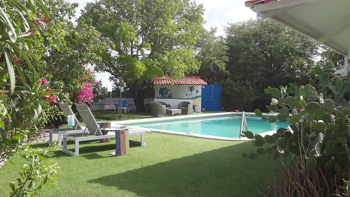 Peaceful, green haven, centrally located with pool