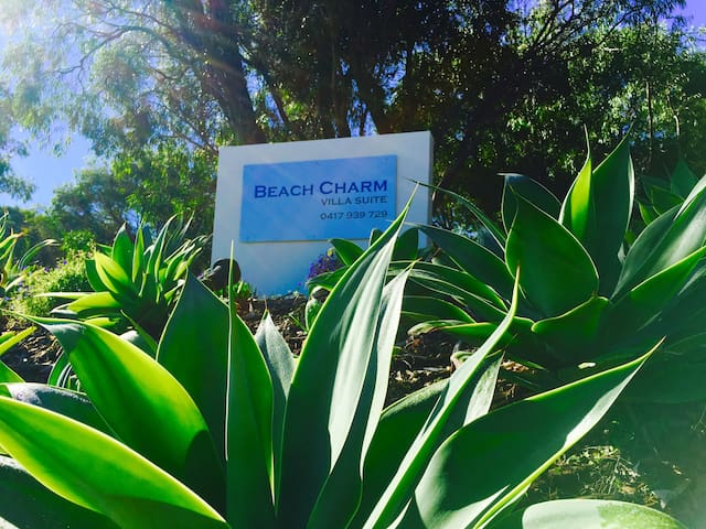 Beach Charm Villa Suite. Sign is out the front and lit up till 10pm.