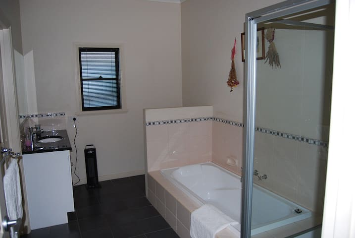 Full size bath separate shower, plus toilet.