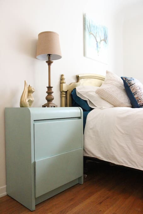 Night stand has extra drawer space and an extension cord for your cell phone.