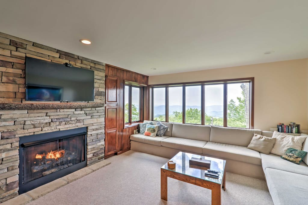 Warm up by the fireplace at night in the welcoming living room.