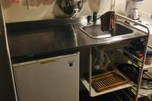 Kitchenette has sink, small microwave, coffee maker,  toaster, fridge and electric cook top. Pots and pans and plates and dishes provided.