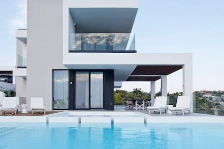 Contemporary Epsilon Horizon villa with staff.