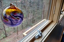 View of back ravine in the winter from loft.  Glass ornament from New Morning Gallery...my fave!