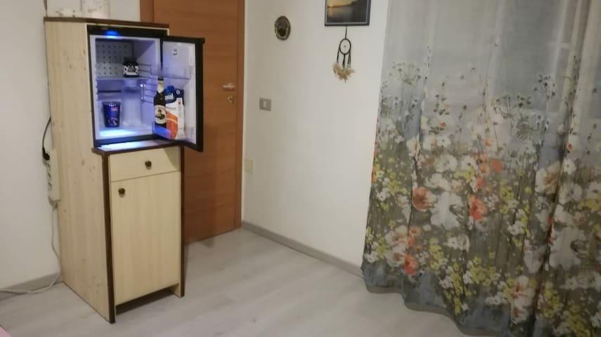 Private mini-fridge in bedroom